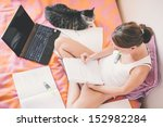 Stock photo woman studying on the bed 152982284
