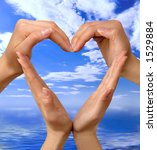 Conceptual heart symbol made from hands over blue seascape isolated with clipping path - stock photo