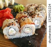 Small photo of Macro photo sushi rolls with eel and ginger. Stock photo Asian food sushi set