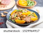 fried pork with peaches  cashew ... | Shutterstock . vector #1529964917
