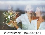 young lesbian couple holding... | Shutterstock . vector #1530001844