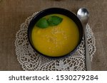 Pumpkin Soup In A Ceramic Blue...
