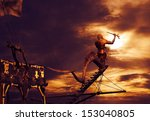 Pirate ship sailing in sunset - stock photo