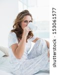 attractive woman resting in bed ... | Shutterstock . vector #153061577