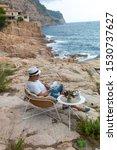 man resting by the seaside in...   Shutterstock . vector #1530737627