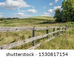 Weathered Old Fence Around An...