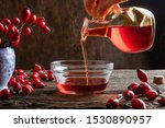 Pouring Rose Hip Seed Oil Into...