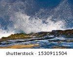 Waves Crashing On Rocks In La...