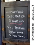 Text board with advertisement for wine tasting at a French restaurant - stock photo