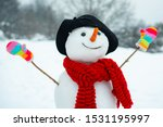 Funny snowman in stylish hat...