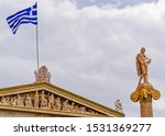 Small photo of Apollo the ancient Greek god and Greek flag on the Athens academy building