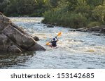 Rear View Of A Man Rafting Wit...