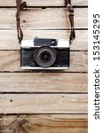 Old Camera And On Wooden Table...