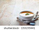 bowl of squash soup on a wooden ...   Shutterstock . vector #153155441