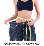 slim girl in big jeans isolated ... | Shutterstock . vector #153255269