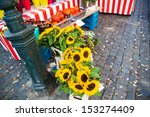 detail of an autumnal market with sunflowers - stock photo