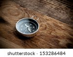 Compass On A Wooden Background