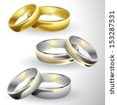 Gold and silver wedding rings in pair