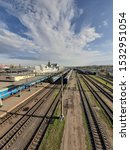 Small photo of Train station, train tracks, passenger trains and blue skies with white clouds