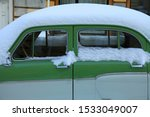 Old  Snow Covered Car On The...