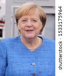 Small photo of Kiel, Germany, 3. October 2019. Chancellor Angela Merkel at the unitary ceremony in Kiel. She wears a blue blouse and a necklace around her neck.