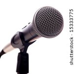 A microphone on a white background with copy space - stock photo