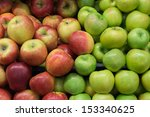 Green And Red Apples On Shelf