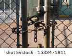 Rusty Old Lock Chain On Fence