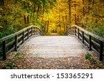 Wooden Bridge In The Autumn Park
