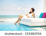 woman on sunbed | Shutterstock . vector #153382934