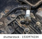Closeup of spark plug removed from small gas engine on lawn mower. Concept of home dyi maintenance, tune-up and repair