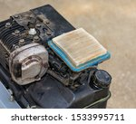 Dirty air filter on small gas engine of garden tiller. Concept of home dyi maintenance, tune-up, and repair