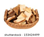 Full basket of different sliced bread. Isolated on a white background. - stock photo