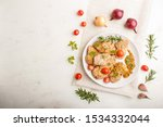 fried pork chops with tomatoes... | Shutterstock . vector #1534332044