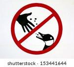 do not feed ducks sign in a... | Shutterstock . vector #153441644