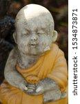 Cute Baby Buddha In Robes...