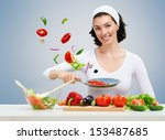 woman in kitchen making salad | Shutterstock . vector #153487685