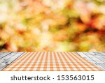 empty wooden table and autumn... | Shutterstock . vector #153563015