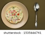 omelet on a beige  plate on an...