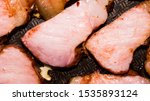 Small photo of The roasted carbonate.Background of roasted carbonate.Smoked carbonate.