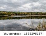 Lake In Autumn Forest Under...