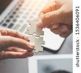 Small photo of Business solutions, Businesswoman hand connecting jigsaw with businessman hand. success and strategy and partner concept.