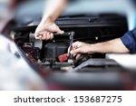 hands of car mechanic in auto... | Shutterstock . vector #153687275