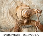 Antique stone grinding wheel and axel