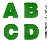 letters a b c d made of green...
