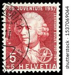 Small photo of LUGA, RUSSIA - OCTOBER 15, 2019: A stamp printed by SWITZERLAND shows Swiss physicist, mathematician, astronomer, geographer, logician and engineer Leonhard Euler, circa 1957