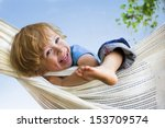 Laughing Child In Hammock