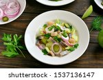 Stock photo herring salad with potato onion marinated cucumber and apple on wooden table 1537136147