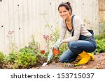 Smiling woman autumn gardening...