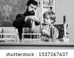 Stock photo chemistry experiment school clubs interactive education teacher and pupils test tubes in 1537267637